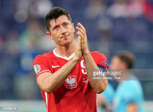 Robert Lewandowski of Poland acknowledges the Poland fans following their side's defeat in the UEFA Euro 2020 Championship Group E match between...