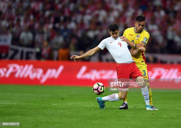 Robert Lewandowski of Poland and Alin Tosca of Romania in action during the 2018 FIFA World Cup Russia eliminations match between Poland and Romania...