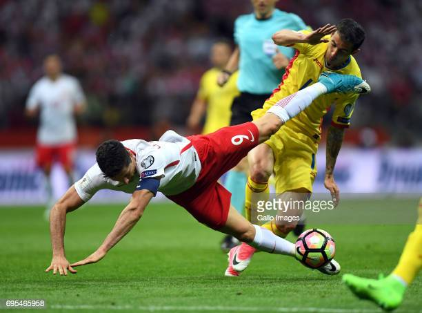Robert Lewandowski of Poland and Bogdan Stancu of Romania in action during the 2018 FIFA World Cup Russia eliminations match between Poland and...