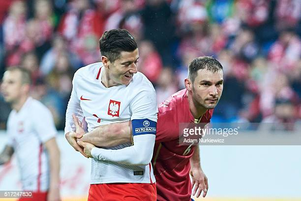 Robert Lewandowski of Poland and Branislav Ivanovic of Serbia hold each other during the international friendly soccer match between Poland and...