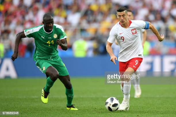 Robert Lewandowski of Poland and Cheikh Ndoye of Senegal in action during the 2018 FIFA World Cup Russia group H match between Poland and Senegal at...