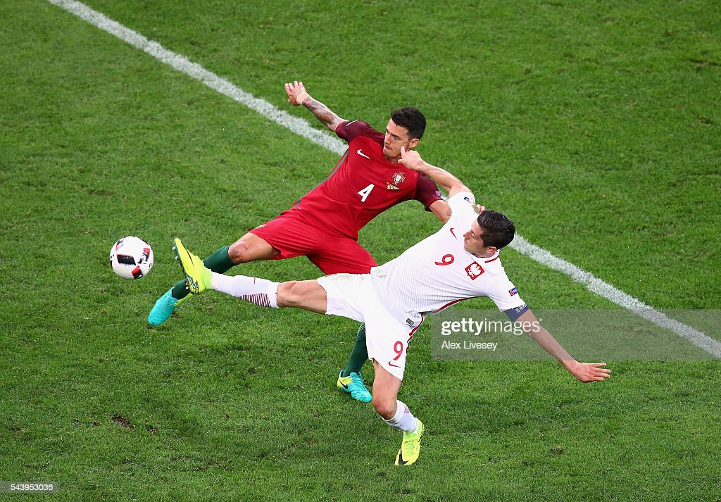Robert Lewandowski of Poland and Jose Fonte of Portugal compete for the ball during the UEFA EURO 2016 quarter final match between Poland and Portugal at Stade Velodrome on June 30, 2016 in Marseille, France.