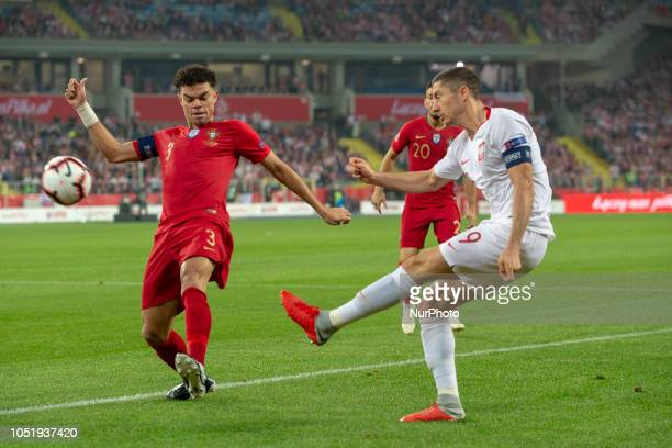 Robert Lewandowski of Poland and Pepe of Portugal in action during UEFA Nations League A match between Poland and Portugal at Silesian Stadium in...