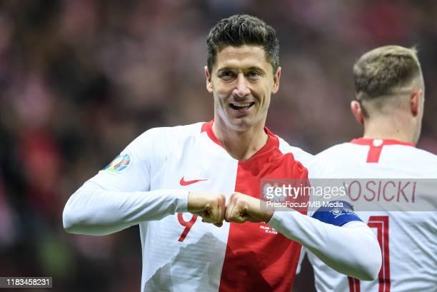 Robert Lewandowski of Poland celebrates after scoring a goal during the UEFA Euro 2020 Qualifier between Poland and Slovenia on November 19, 2019 in...