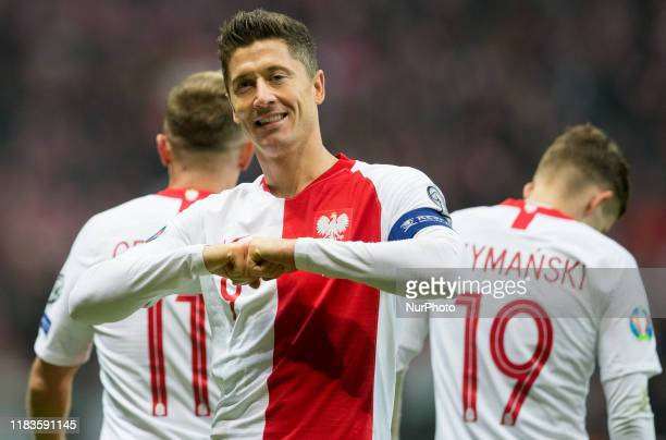 Robert Lewandowski of Poland celebrates after scoring a goal during the UEFA Euro 2020 Qualifier between Poland and Slovenia on November 19, 2019 in...