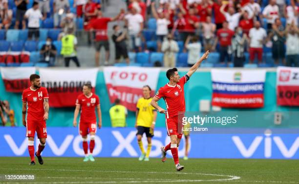 Robert Lewandowski of Poland celebrates after scoring their side's first goal during the UEFA Euro 2020 Championship Group E match between Sweden and...