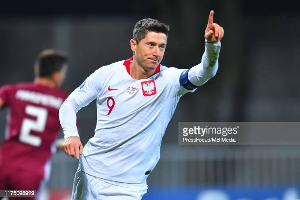 Robert Lewandowski of Poland celebrates scoring a goal during the UEFA Euro 2020 qualifier between Latvia and Poland on October 10, 2019 in Riga,...