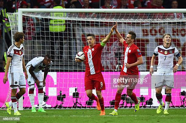 Robert Lewandowski of Poland celebrates scoring his team's opening goal with Arkadiusz Milik of Poland during the EURO 2016 Qualifier Group D match...