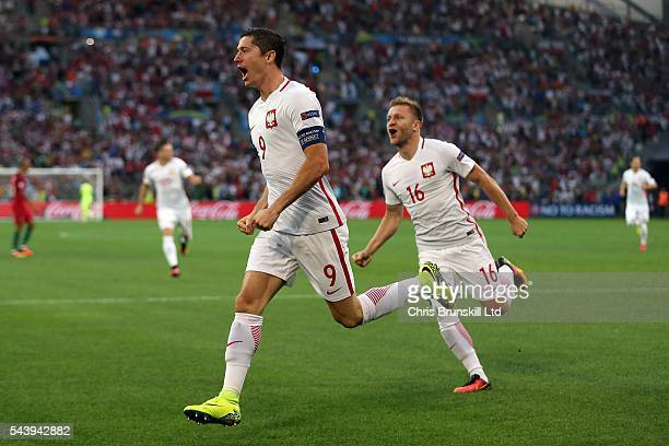 Robert Lewandowski of Poland celebrates scoring the opening goal during the UEFA Euro 2016 Quarter Final match between Poland and Portugal at Stade...