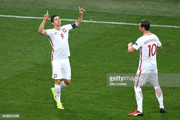 Robert Lewandowski of Poland celebrates scoring the opening goal with his team mate Grzegorz Krychowiak during the UEFA EURO 2016 quarter final match...
