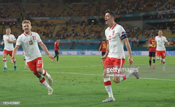 Robert Lewandowski of Poland celebrates with Kamil Jozwiak after scoring their side's first goal during the UEFA Euro 2020 Championship Group E match...