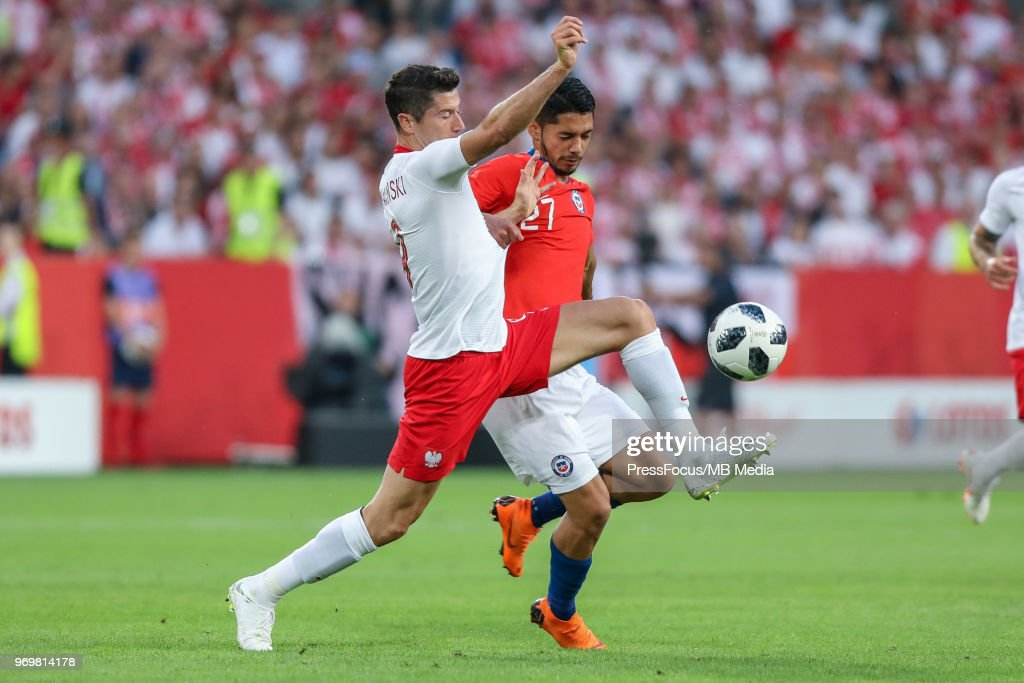 Robert Lewandowski of Poland competes with Jimmy Antonio Martinez of Chile during International Friendly match between Poland and Chile on June 8, 2018 in Poznan, Poland.