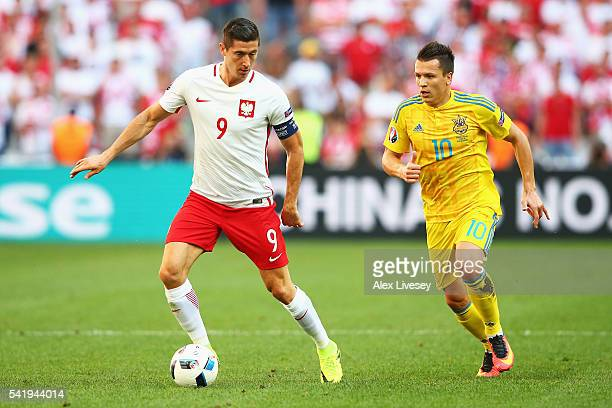 Robert Lewandowski of Poland controls the ball under pressure from Yevhen Konoplyanka of Ukraine during the UEFA EURO 2016 Group C match between...