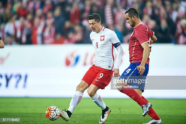 Robert Lewandowski of Poland fights for the ball with Nikola Maksimovic of Serbia during the international friendly soccer match between Poland and...