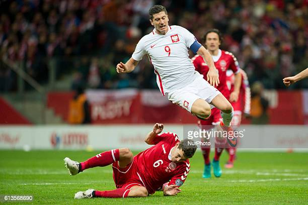 Robert Lewandowski of Poland fouled by Andreas Christensen of Denmark during the FIFA World Cup 2018 Qualifying Group E match between Poland and...