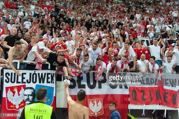 Robert Lewandowski of Poland gives his jersey for the polish supporters during the 2020 UEFA European Championships group G qualifying match between...