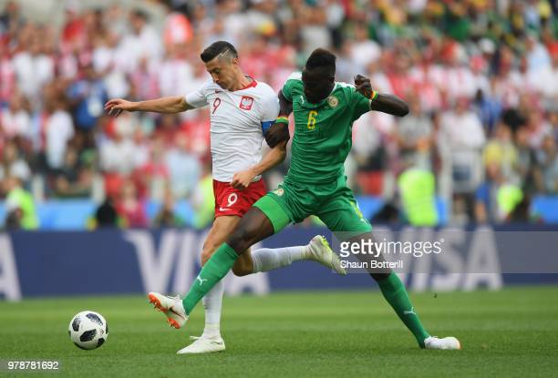 Robert Lewandowski of Poland is challenged by Salif Sane of Senegal during the 2018 FIFA World Cup Russia group H match between Poland and Senegal at...