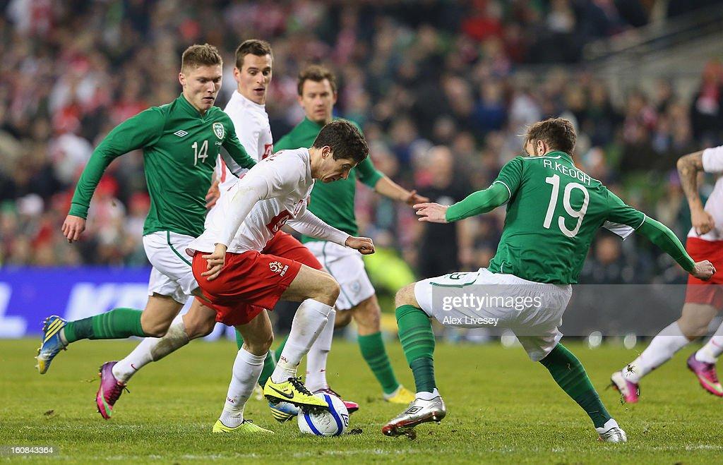 Robert Lewandowski of Poland is put under pressure from Richard Keogh of Republic of Ireland during the International Friendly match between Republic of Ireland and Poland at Aviva Stadium on February 6, 2013 in Dublin, Ireland.