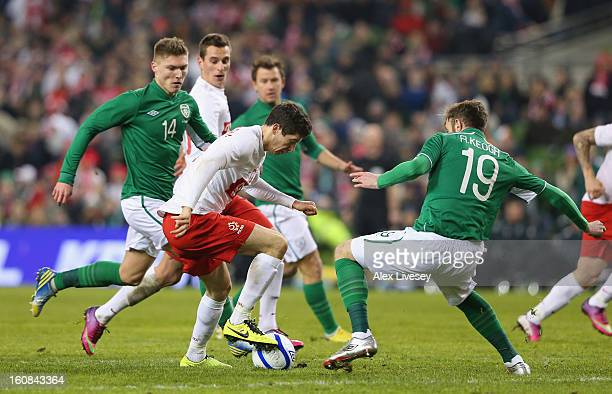 Robert Lewandowski of Poland is put under pressure from Richard Keogh of Republic of Ireland during the International Friendly match between Republic...