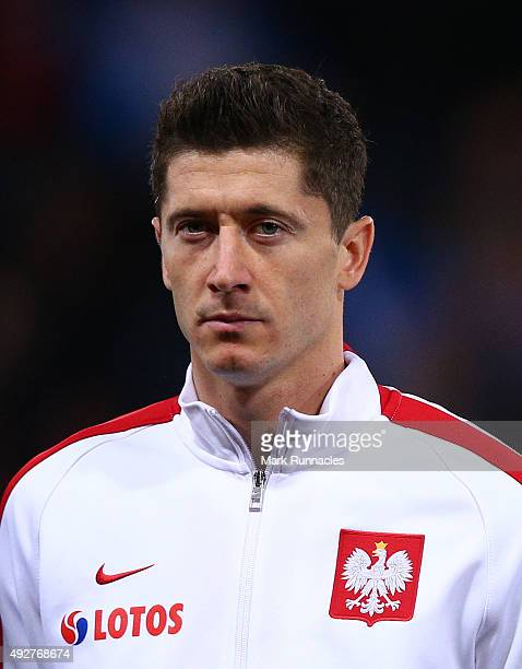 Robert Lewandowski of Poland lines up for the national anthem during the EURO 2016 Qualifier between Scotland and Poland at Hamden Park on October 8...