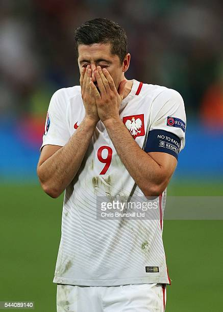 Robert Lewandowski of Poland looks dejected at fulltime following the UEFA Euro 2016 Quarter Final match between Poland and Portugal at Stade...