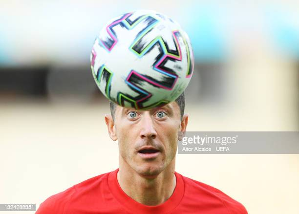 Robert Lewandowski of Poland looks on at the ball during the Poland Training Session ahead of the UEFA Euro 2020 Group E match between Spain and...