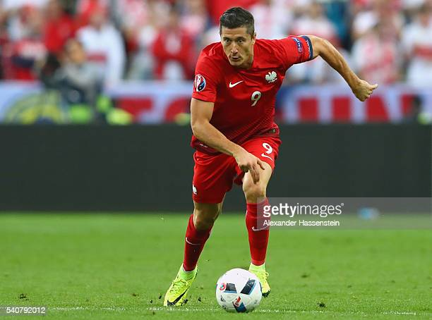 Robert Lewandowski of Poland runs with the ball during the UEFA EURO 2016 Group C match between Germany and Poland at Stade de France on June 16 2016...