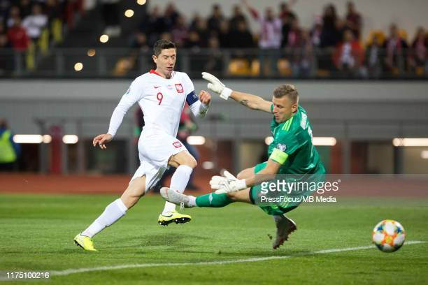 Robert Lewandowski of Poland scores a goal during the UEFA Euro 2020 qualifier between Latvia and Poland on October 10, 2019 in Riga, Latvia.