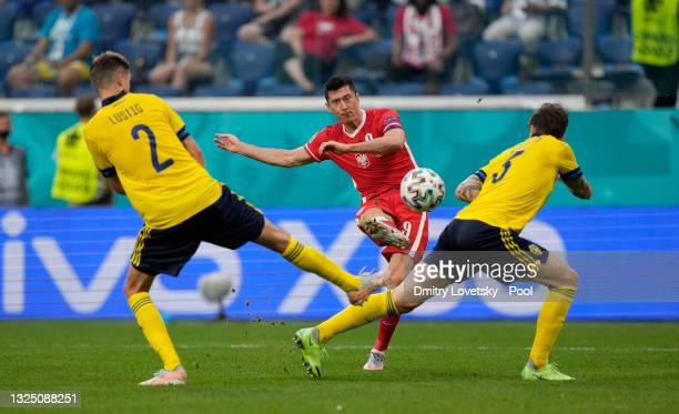 Robert Lewandowski of Poland scores their side's first goal during the UEFA Euro 2020 Championship Group E match between Sweden and Poland at Saint...