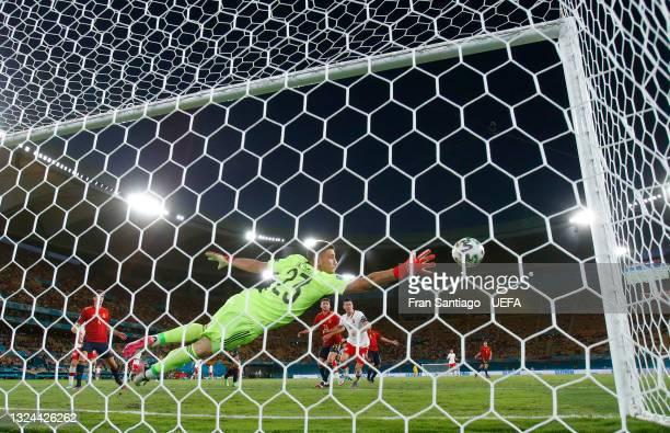 Robert Lewandowski of Poland scores their side's first goal past Unai Simon of Spain during the UEFA Euro 2020 Championship Group E match between...