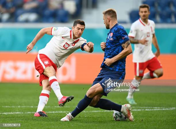 Robert Lewandowski of Poland shoots whilst under pressure from Milan Skriniar of Slovakia during the UEFA Euro 2020 Championship Group E match...