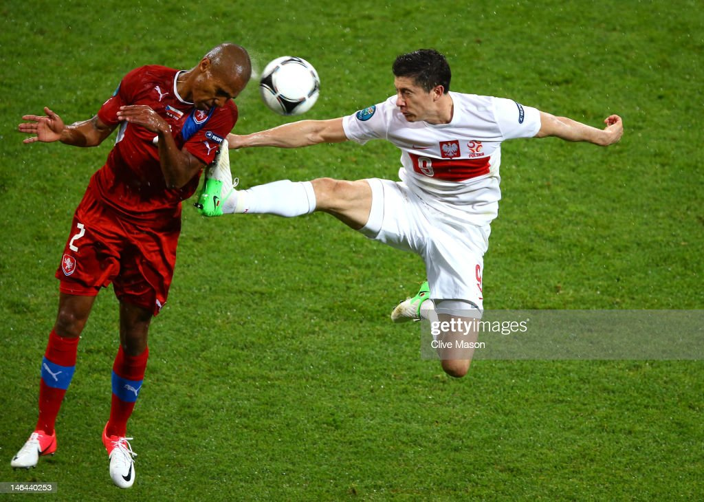 Robert Lewandowski of Poland tackles Theodor Gebre Selassie of Czech Republic during the UEFA EURO 2012 group A match between Czech Republic and Poland at The Municipal Stadium on June 16, 2012 in Wroclaw, Poland.