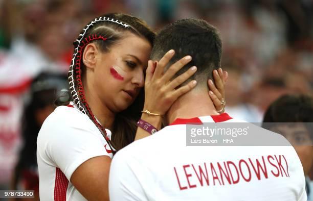 Robert Lewandowski of Poland's girlfriend Anna Stachurska consoles Robert Lewandowski following his sides defeat in the 2018 FIFA World Cup Russia...