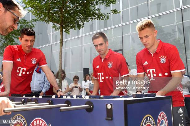 Robert Lewandowski Philiip Lahm and Joshua Kimmich of FC Bayern Muenchen play a fun table top football match at Paulaner headquarter Munich on May 17...