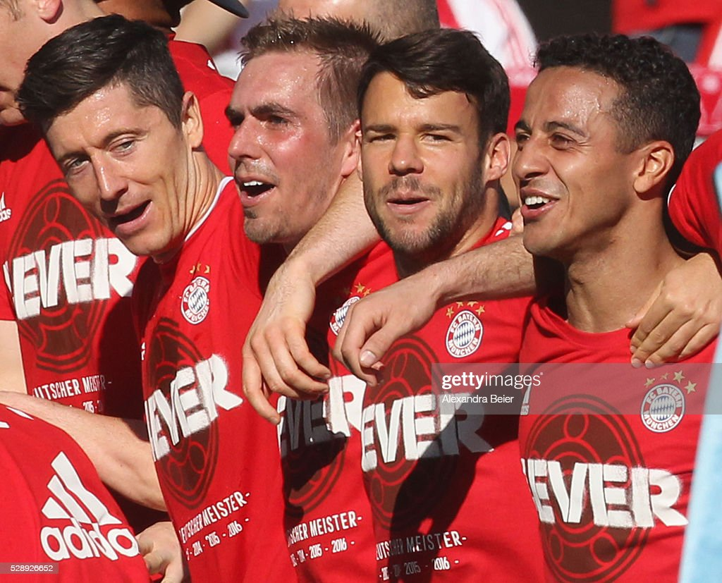 Robert Lewandowski, Philipp Lahm, Juan Bernat and Thiago (L-R) of Bayern Muenchen celebrate their German Championship title after the Bundesliga match between FC Bayern Muenchen and FC Ingolstadt at Audi Sportpark on May 7, 2016 in Ingolstadt, Germany.