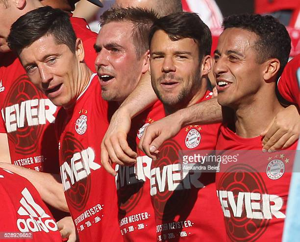 Robert Lewandowski Philipp Lahm Juan Bernat and Thiago of Bayern Muenchen celebrate their German Championship title after the Bundesliga match...