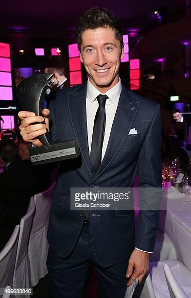 Robert Lewandowski presents his award during the Audi Generation Award 2015 at Hotel Bayerischer Hof on December 2 2015 in Munich Germany