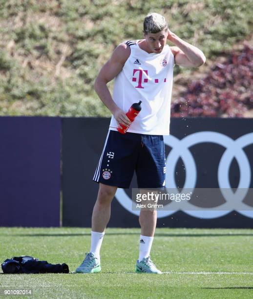 Robert Lewandowski refrehes during a training session on day 3 of the FC Bayern Muenchen training camp at ASPIRE Academy for Sports Excellence on...