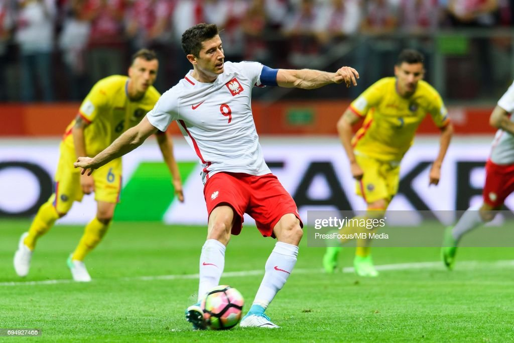 Robert Lewandowski scores a goal during World Cup 2018 qualifier between Poland and Romania on June 10, 2017 in Warsaw, Poland.'n