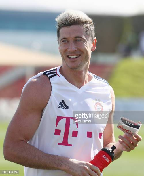 Robert Lewandowski smiles during a training session on day 3 of the FC Bayern Muenchen training camp at ASPIRE Academy for Sports Excellence on...
