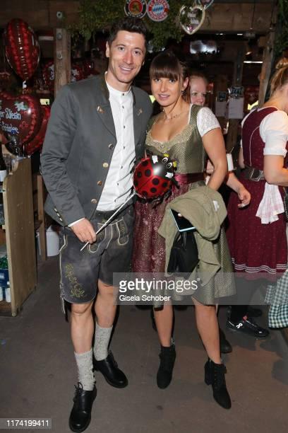 "Robert Lewandowski soccer player FC Bayern Muenchen and his wife Anna Lewandowska during the annual ""FC Bayern Wiesn"" at Kaeferschaenke beer tent /..."