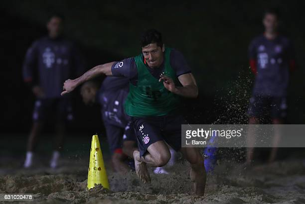 Robert Lewandowski sprints in the sand during a training session at day 3 of the Bayern Muenchen training camp at Aspire Academy on January 5 2017 in...