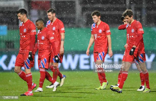 Robert Lewandowski, Thomas Mueller of Bayern Munich and teammates react as they prepare to go into extra-time during the DFB Cup second round match...