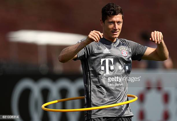 Robert Lewandowski tries a hula hoop dance during a training session at day 3 of the Bayern Muenchen training camp at Aspire Academy on January 5...