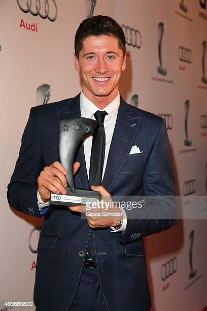 Robert Lewandowski with award during the Audi Generation Award 2015 at Hotel Bayerischer Hof on December 2 2015 in Munich Germany