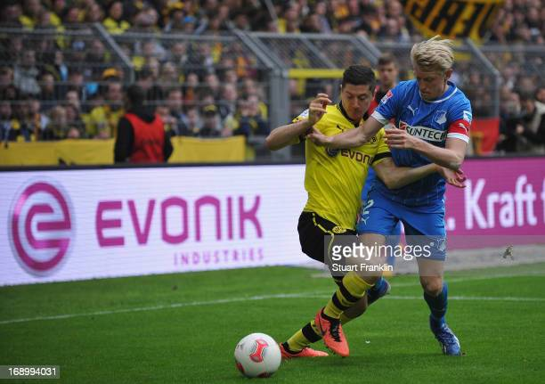 Robert Lewendowski of Dortmund is challenged by Andreas Beck of Hoffenheim during the Bundesliga match between Borussia Dortmund and TSG 1899...