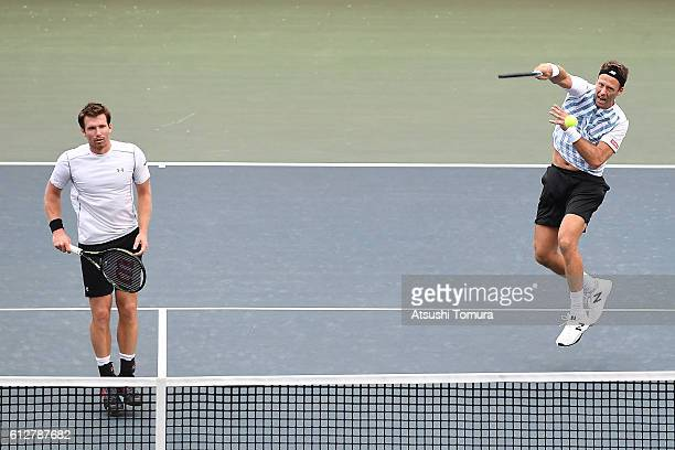 Robert Lindstedt of Sweden and Alexander Peya of Austria in action during the men's doubles first round match against Henri Kontinen of Finland and...