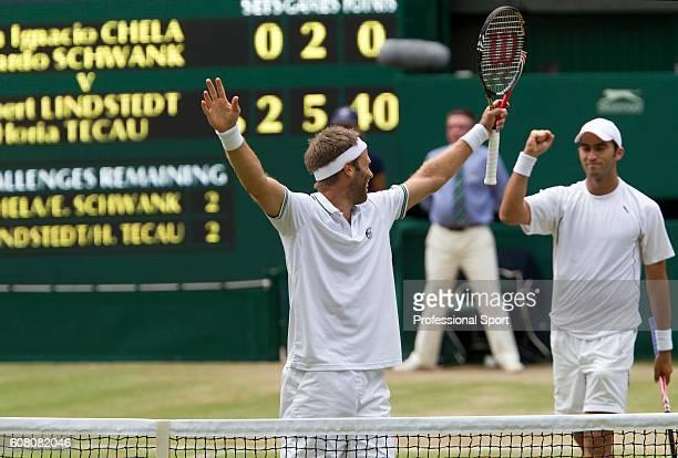 Robert Lindstedt of Sweden and Horia Tecau of Romania celebrate victory in their Men's Doubles match against Juan Ignacio Chela and Eduardo Schwank...