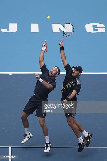 Robert Lindstedt of Sweden and Horia Tecau of Romania complete against Nenad Zimonjic of Serbia and Michael Llodra of France during the men's doubles...