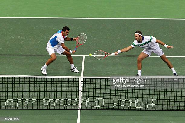 Robert Lindstedt of Sweden and Horia Tecau of Romania in action against Marcel Granollers and Marc Lopez of Spain in the doubles semi final on day 6...